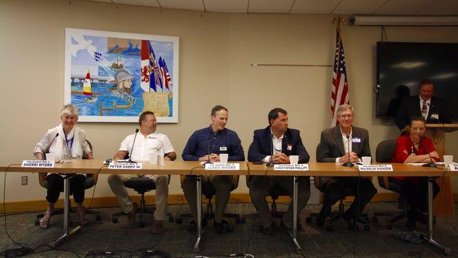 Pensacola City Council candidates await the start of a candidate forum at Pensacola City Hall on Thursday, June 28, 2018.