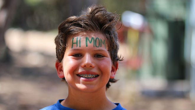 Waldo's facial recognition software scans for matches to uploaded headshots of children. Pictures of kids at camp are then sent to parents as a text message alert.