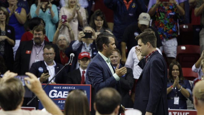 Rep. Matt Gaetz and Donald Trump Jr. greet each other at a rally in Niceville on Thursday, Aug. 2, 2018.