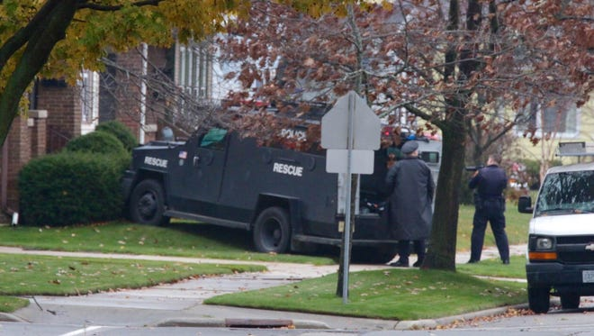 An armored vehicle rests up against a house where a 21-year-old man held police at bay since 8:30 p.m. Monday, after making statements that worried his family.