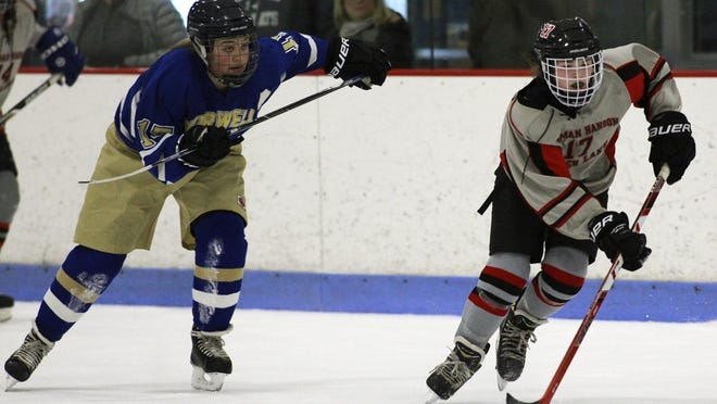 Natalie Nemes sprints down the ice as Norwell's Casey Ward skates back onto defense. Nemes started her high school career at Silver Lake before moving on to Tabor Academy.