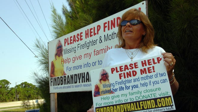 Lynn Troup of West Melbourne poses at the intersection of Babcock Street and Malabar Road in Palm Bay while she discusses her friend's Brandy Hall, August 2006 disappearance.