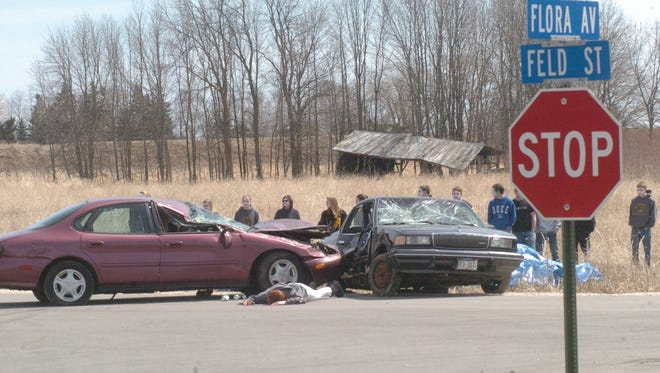 Algoma High School students observe a simulated drunken driving car crash.