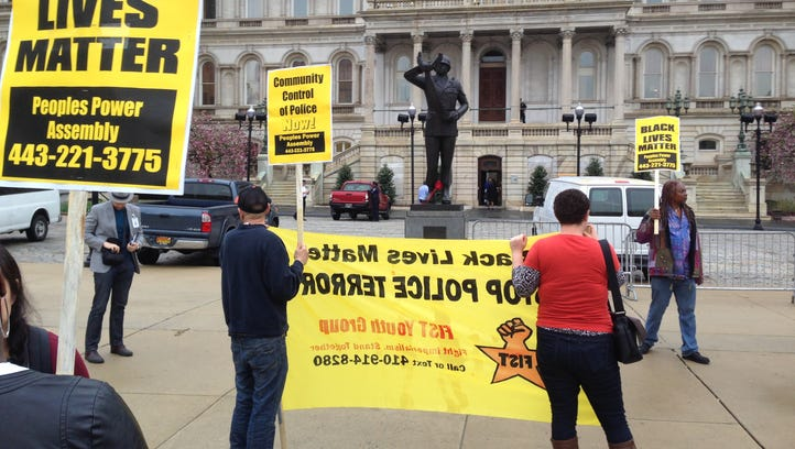 Demonstrators protest the death of Freddie Gray outside