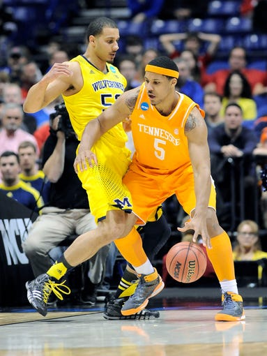 Tennessee forward Jarnell Stokes (5) posts up against Michigan forward Jordan Morgan (52) in the first half.