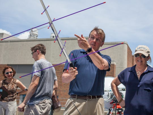 Tim Holman explains how the satellite system will work to locate a massive, high-altitude weather balloon after it is launched from the top floor of the 25th Avenue Garage on VanderbiltÕs campus in Nashville, Tenn., Tuesday, June 20, 2017. The launch is part of a nationwide test leading up to the Aug. 21 total solar eclipse.