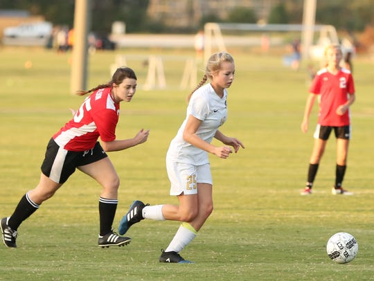 Westview's Anne Carithers is chased by a McKenzie player during the Chargers' 7-3 win last season.