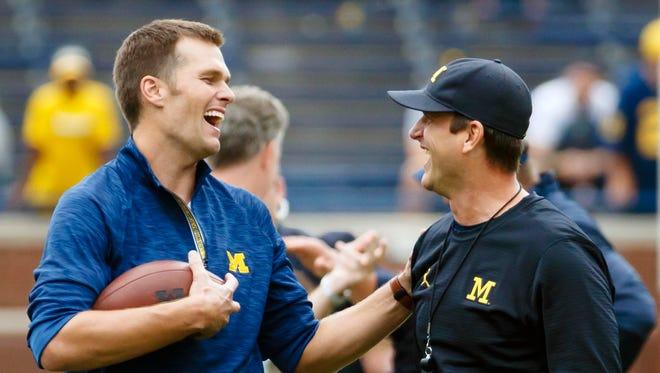 Patriots quarterback Tom Brady and Michigan coach Jim Harbaugh laugh before U-M's 45-28 win over Colorado in Ann Arbor on Sept. 17, 2016.