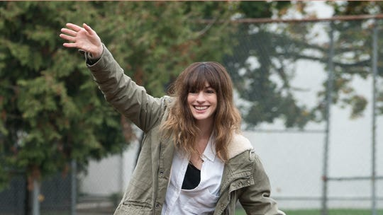 Gloria (Anne Hathaway) leaves New York and returns