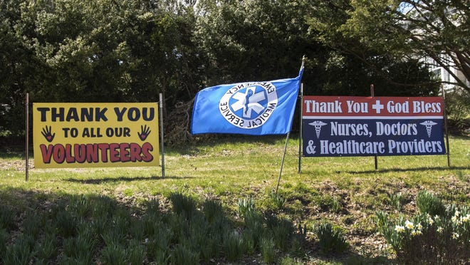A flag and banner supporting healthcare workers and volunteers at Maple Terrace Farms along Route 94 in Warwick on Saturday.