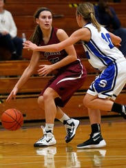 Mayville's Paige Persha tries to get around St. Mary's