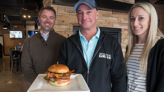 """Andy Hargreaves, Tom """"Spoon"""" Busard and Victoria Sequin have opened Spoon's Place, where sports fans can find 33 large-screen TVs to watch their favorite games."""