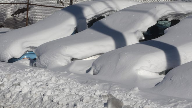 Cars are covered with snow at Manahawkin Auto Sales  after February snow storm.    Photo by Robert Ward 02/07/10   Stafford   #38925