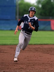Aaron Sines rounds third base on his way to scoring