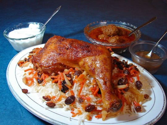 Kabuli pilau - baked chicken covered with Afghan rice,