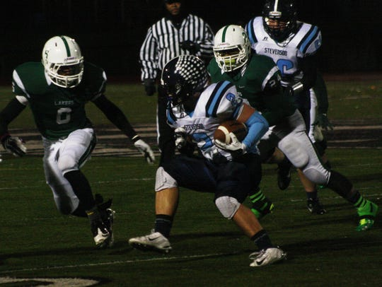 Livonia Stevenson's Austin Petrie gained 116 yards