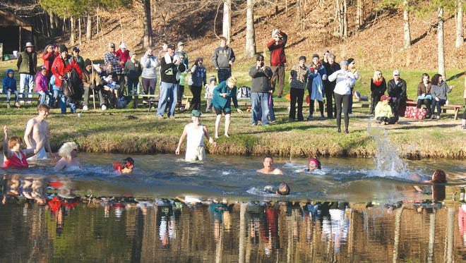 Brave souls take a leap of faith and jump into the cool waters of Camp Whippoorwill Pond on New Years Day at the Fifth Annual Fernvale Polar Plunge.
