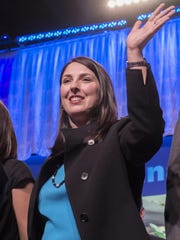 Ronna Romney McDaniel waves to delegates at the Michigan Republican Party Convention Feb. 21, 2015, at the Lansing Center.
