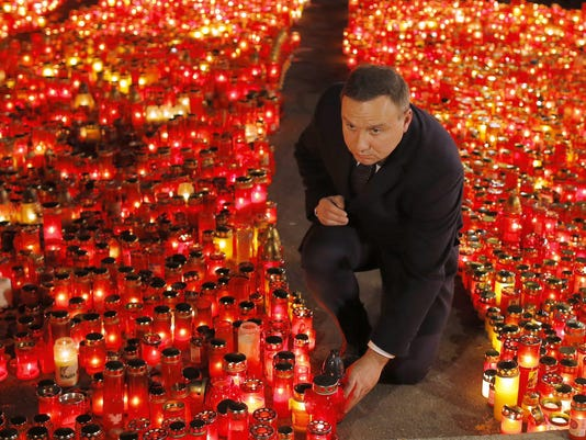 Polish President Andrzej Duda pays respect for the victims of the nightclub fire accident
