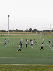 A soccer team trains at Grand Park in August 2014.