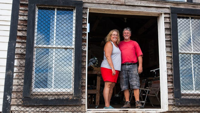 Middlebrook artists Alice Hailey-Stout and Novil Stout stand in the 150-year-old corn crib that now serves as Novil's wood shop behind their home on Tuesday, Sept. 8, 2015.