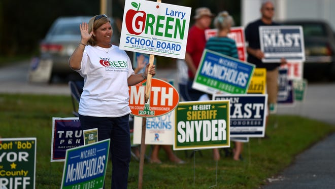 Jennifer Thomas, of Palm City, campaigns for Martin County School Board candidate Larry Green at the Cummings Library on Matheson Avenue in Palm CIty on election Tuesday, Nov. 8, 2016.