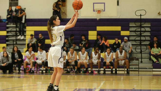 Burges' Natalie Sanchez sinks a free throw after an intentional foul was called against an Eastlake player.