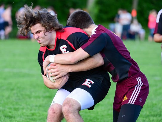Ankeny's Hunter Staab tackles East's Frank Sawhill