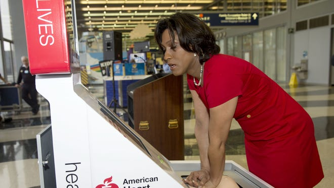 Danielle DeVito, National American Heart Association Volunteer, demonstrates the Hands-Only CPR Training Kiosk provided at Chicago's O'Hare International Airport's Terminal 2 on Feb. 24, 2016.