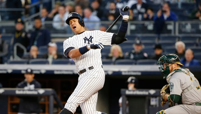 New York Yankees designated hitter Alex Rodriguez reacts in a first-inning at-bat against the Oakland Athletics in which he struck out with the bases loaded in a baseball game in New York, Wednesday, April 20, 2016.