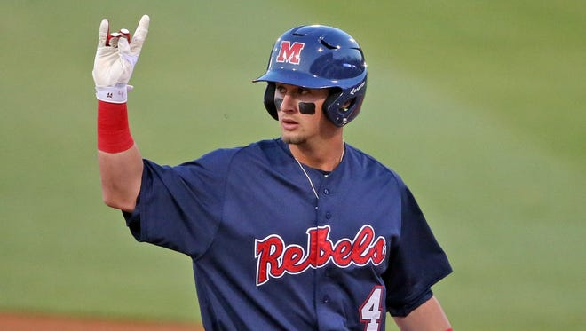 Second baseman Tate Blackman signals to the Ole Miss dugout after hitting a double against South Carolina on March 24. He's taken a drastic step forward after struggling as a freshman last season.