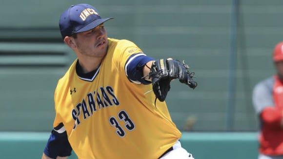 Enka alum Matt Frisbee was the winning pitcher Saturday as the UNC Greensboro baseball team eliminated No. 23 St. John's fromthe NCAA tournament.