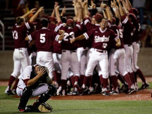 Indiana catcher Kyle Schwarber reacts  as Stamford celebrates after Indiana lost 5-4 to Stanford during an NCAA college baseball regional tournament game in Bloomington, Ind.,  Monday, June 2, 2014.  (AP Photo/AJ Mast)