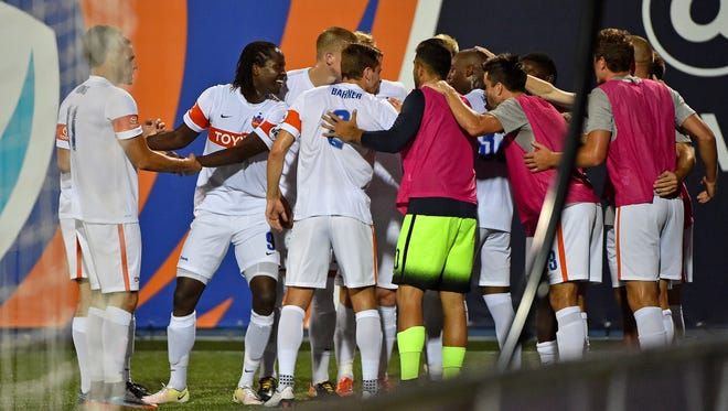 FC Cincinnati forward Djiby Fall (9) celebrates with teammates after scoring a goal against the Miami FC during the second half at Riccardo Silva Stadium. Mandatory