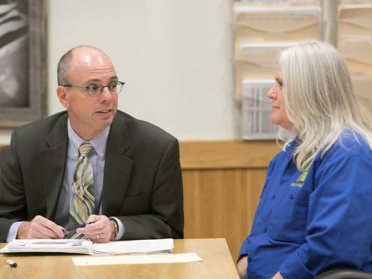Defense attorney Steven Dodge speaks Thursday, Jan. 25, 2018, with his client, Sarah Jane Fluegel, 53, a Fowlerville resident bound over for trial Thursday on charges of operating while intoxicated causing death and reckless driving causing death.