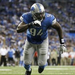 Detroit Lions defensive end Ezekiel Ansah (94) rushes the line during the fourth quarter of an NFL football game against the Minnesota Vikings at Ford Field in Detroit on Sept. 8, 2013.