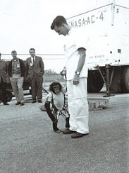 U.S. astronaut Alan Shepard is photographed with chimpanzee