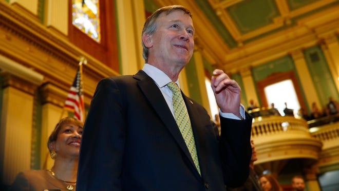 Term-limited Colorado Gov. John Hickenlooper leaves the dais after delivering his final State of the State address to a joint assembly Thursday, Jan. 11, 2018, in the State Capitol in Denver. Hickenlooper encouraged lawmakers to take steps to improve the state's crumbling roadways and to commit to education efforts to prepare the populous for jobs in the ever-changing economy. (AP Photo/David Zalubowski)