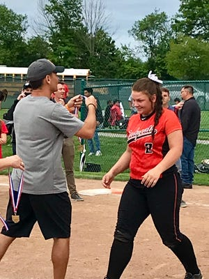 North Union softball senior Avery Clark receives her Division III district championship medal from North Union Athletic Director Nick Hajjar. Clark missed the end of last season with an injured elbow.