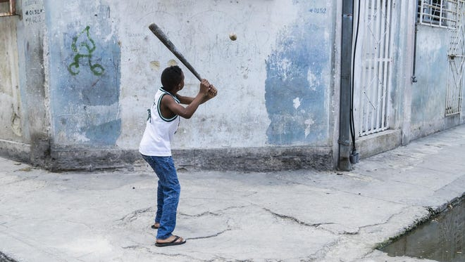 "Kids playing baseball on Concordia and Escobar streets in Centro Havana, Cuba. Binghamton University opens a new exhibit, ""Baseball in Cuba: A Photographic Essay by Ira Block,"" on Sept. 8."