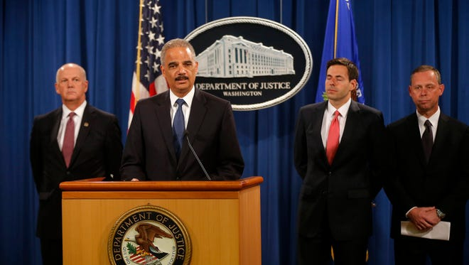 Attorney General Eric Holder, accompanied by Justice Department and FBI officials, announces cyber spying case against China.