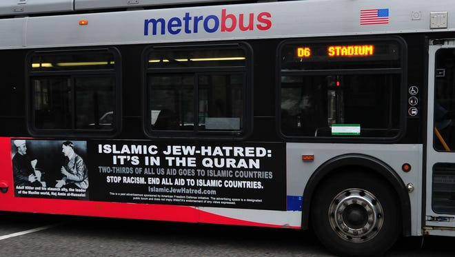 A Metro bus, featuring a controversial ad, drives on a street in Washington, D.C., on May 21, 2014.
