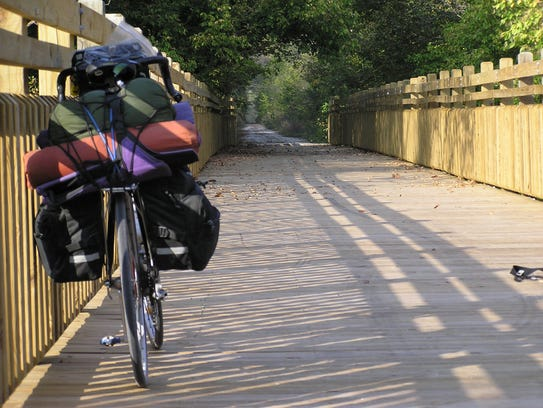A northbound touring bicyclist stops on the historic