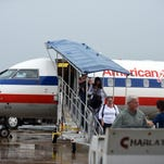 Passengers walk off of the American Eagle airplane at the Hattiesburg-Laurel Regional Airport on Friday. The airport officials have announced an increase in passenger numbers within the past months.