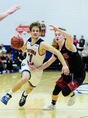 USI's Alex Stein (20) is guarded by Lewis's Josh Niego (31) at USI's Physical Activities Center in Evansville, Ind., Thursday, Nov. 30, 2017. After going into overtime, the Screaming Eagles defeated the Flyers, 84-75.