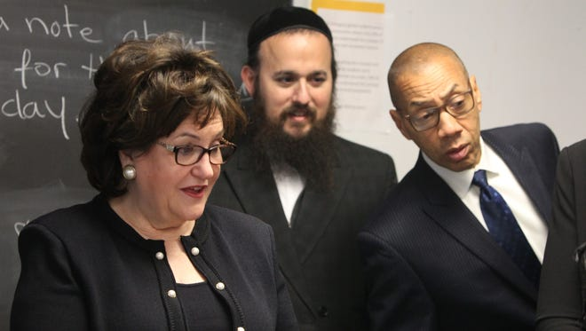 State Education Commissioner MaryEllen Elia, left, with East Ramapo school board President Yehuda Weissmandl and state-appointed monitor team leader Dennis Walcott, during a Feb. 10 visit to district schools.