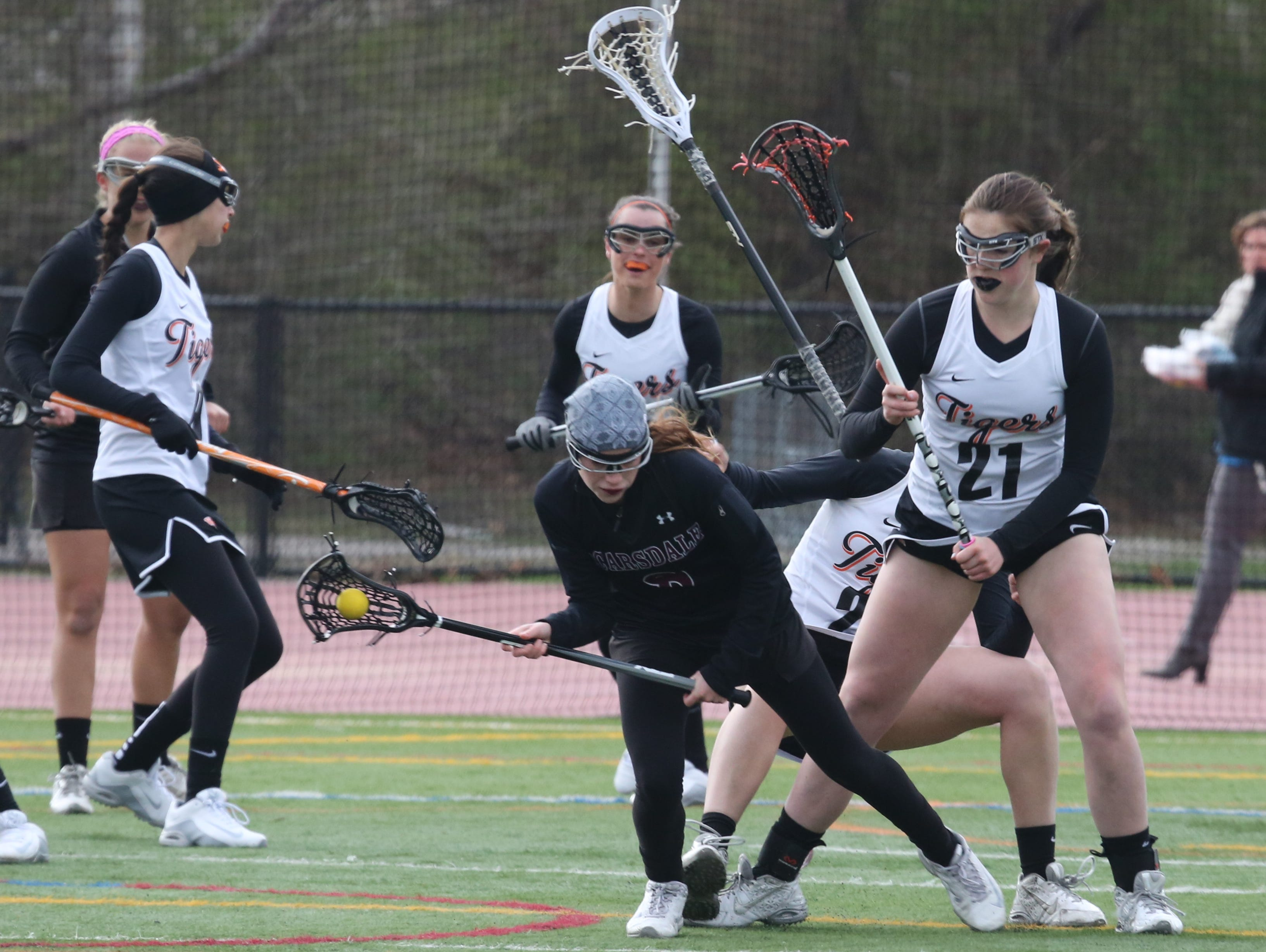 White Plains' Abigail Leone puts pressure on Scarsdale's Jilly Mehlman during their girls lacrosse game at White Plains High School, April 6, 2016.
