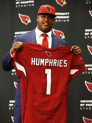 Arizona Cardinals first round draft pick D.J. Humphries shows off his new jersey at the Cardinals practice facility on Friday, May 1, 2015 in Tempe, AZ. Humphries, an offensive tackle from the University of Florida was picked 24th overall in the 2015 NFL Draft.