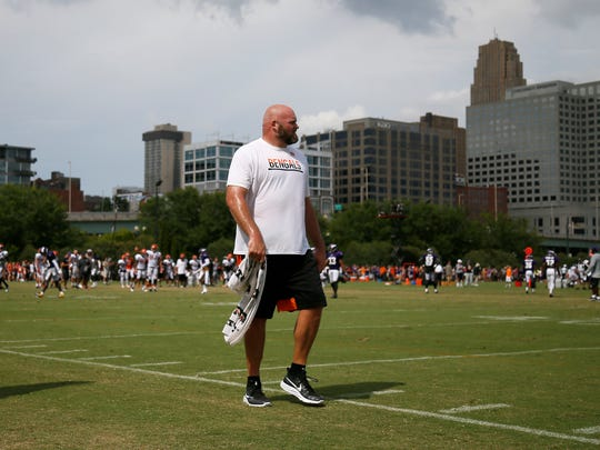 Cincinnati Bengals tackle Andrew Whitworth (77) walks the sideline after a rehab day during practice on Day 13 of training camp at the Paul Brown Stadium practice facility in downtown Cincinnati on Wednesday, Aug. 10, 2016. The Bengals and Vikings met on the practice field for the first of two joint practices ahead the first pre-season game of the year.