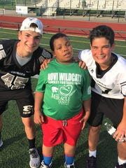 Fantasy football camper Raylen Whitt (middle) partners